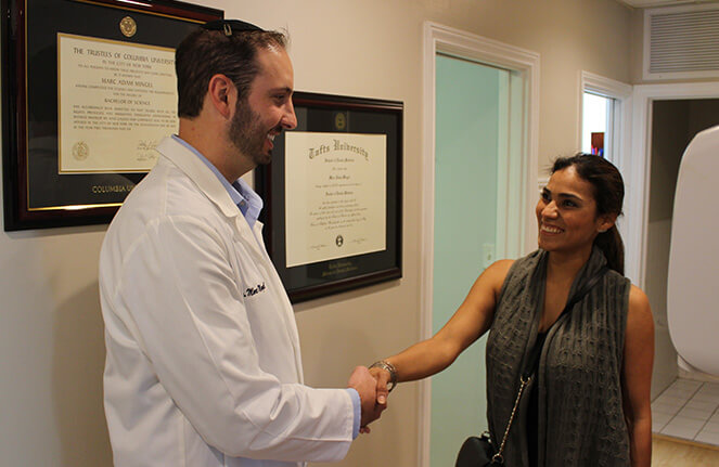 Dr. Mingel shaking hands with patient