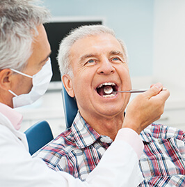 Man in plaid shirt with dentist